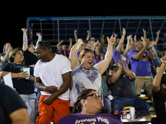 Aransas Pass fans cheers in the stands as the football team gets in to score distance in the fourth quarter against Taft at Akins Wildcat Stadium in Portland on Friday, Sept. 15, 2017.