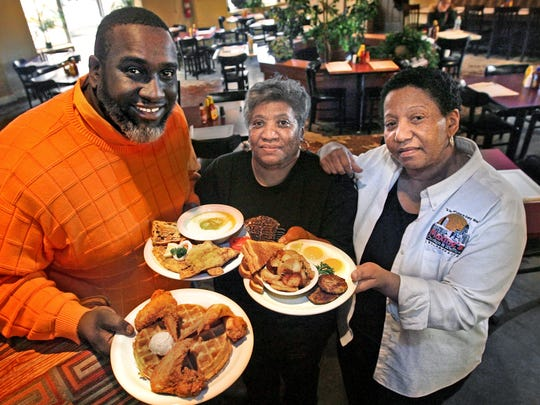 Its a family affair at Maxine's Chicken & Waffles (132 North East Street), Pictured here, (left to right) Brian Bunnell, grandson to Maxine, and two of Maxine's daughters, Donniece Owens, and Shirley Grundy, displaying some waffles, chicken, catfish, grits and potatoes, eggs and sausage, within their main dining room.