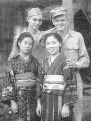 Ed Baumgarten, top left, poses with a fellow paratrooper and two new friends while on occupation duty in Japan after the end of the war.
