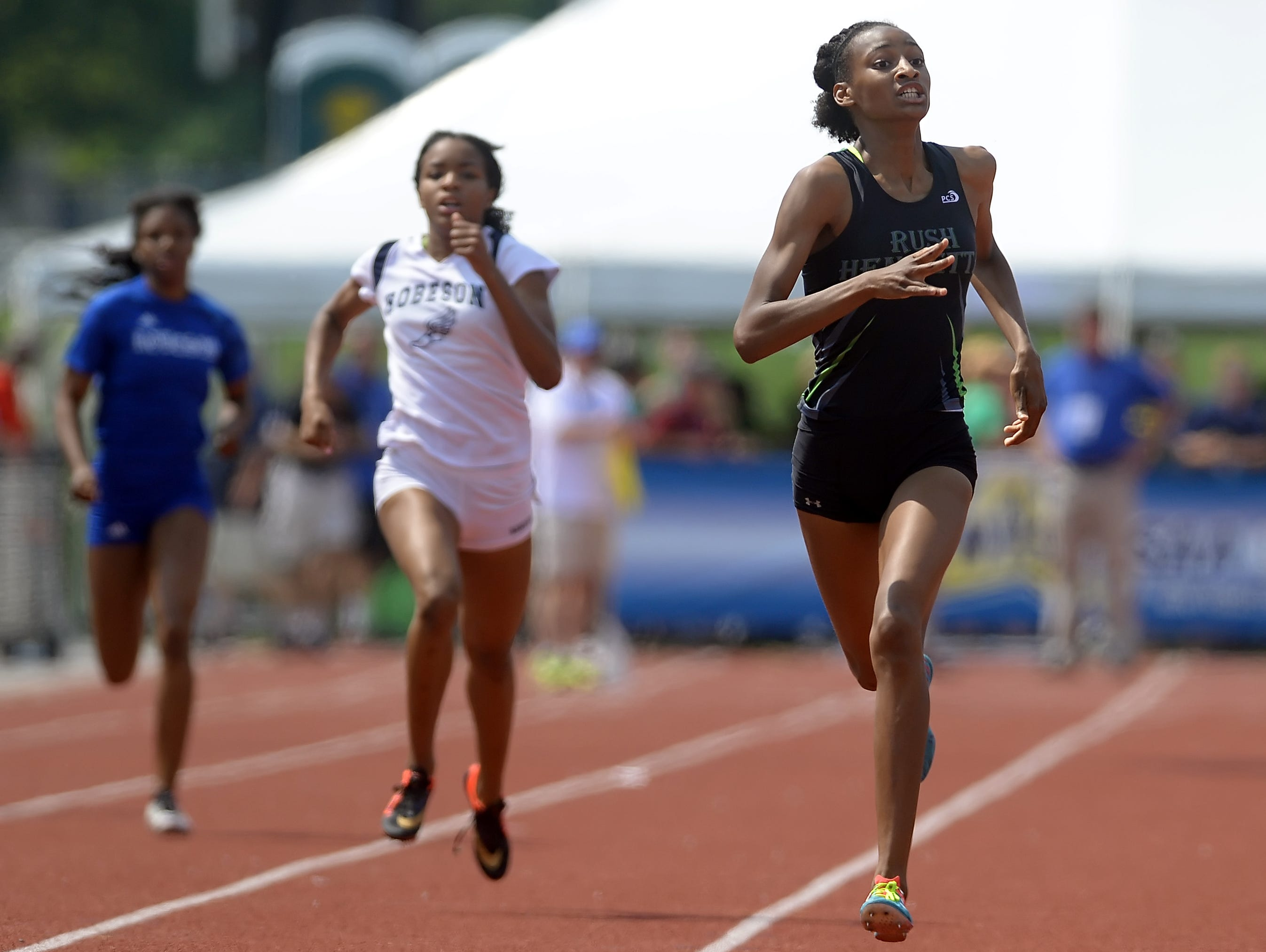 Rush-Henrietta's Sammy Watson, right at the 2015 high school outdoor state meet, won two events in here age division at the USA Track & Field National Junior Olympic Track & Field Championships.