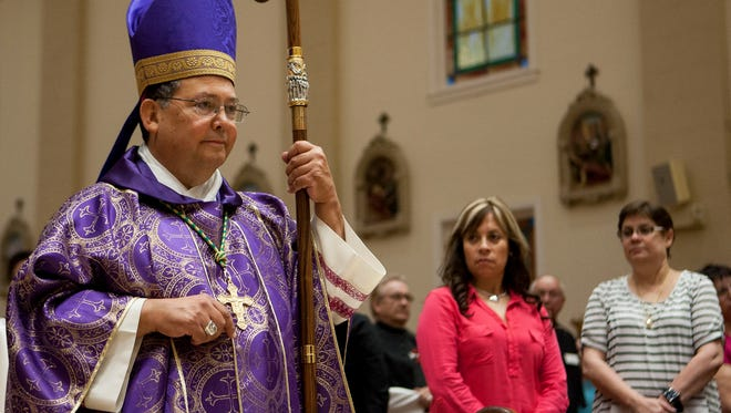 """Bishop Nevares proceeds through the center isle to the front of the Cathedral to begin his sermon, """"Mass for Migrants"""" at the Roman Catholic Diocese of Phoenix in Phoenix, Friday Feb. 20, 2015. Families from across Arizona gathered at the Cathedral to pay respects to those who have died crossing the Sonoran Desert and to support those grieving."""