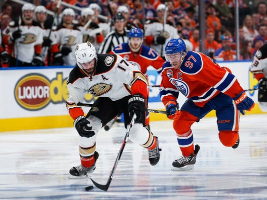 Anaheim Ducks' Ryan Kesler, left, breaks away from Edmonton Oilers' Connor McDavid during the third period of Game 4 of an NHL hockey second-round playoff series, Wednesday, May 3, 2017, in Edmonton, Alberta. (Jeff McIntosh/The Canadian Press via AP)