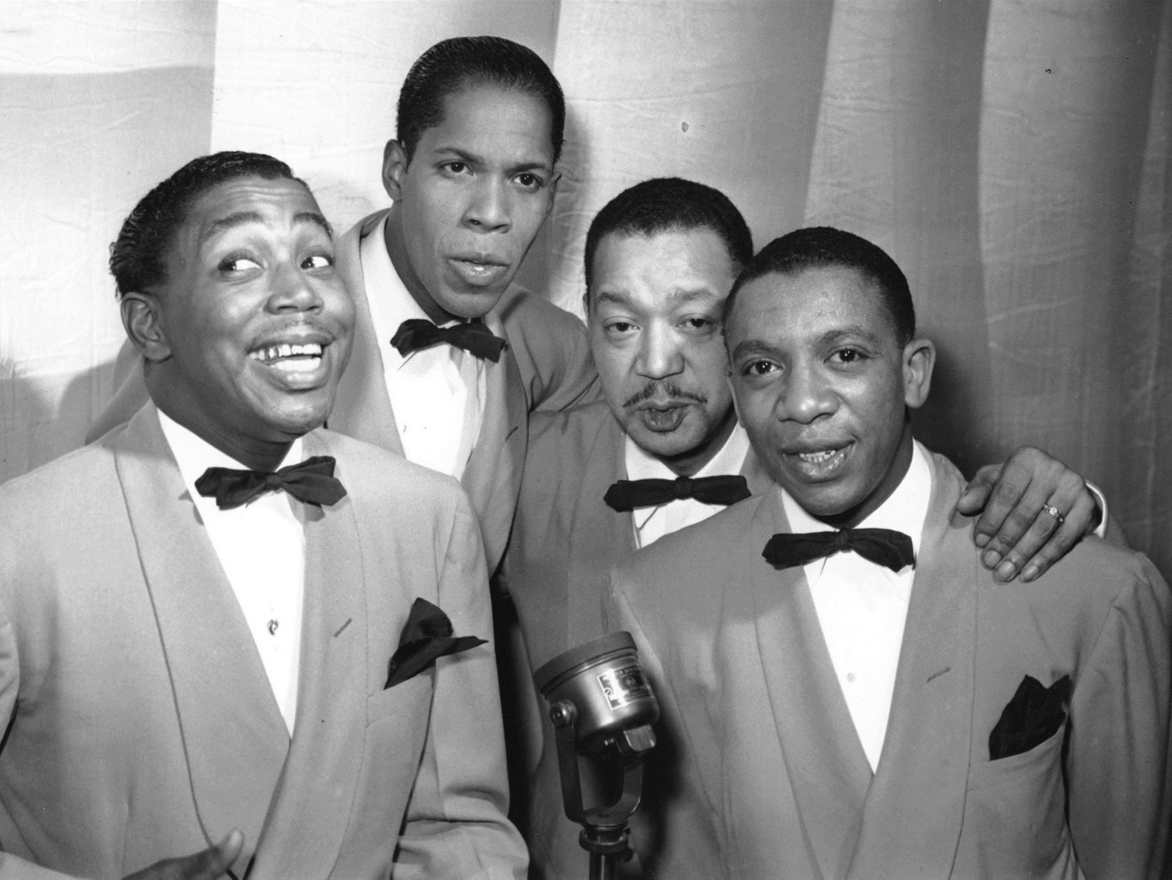 Charlie Fuqua, right, is pictured with the Ink Spots