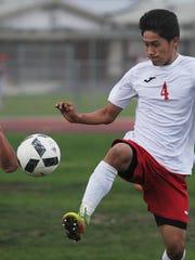 Hueneme's Esteban Mora (4) controls the ball en route