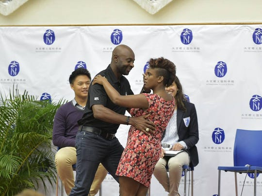 Menya Jefferson, of Gulfport, found herself dancing with Jerry Rice in China over the weekend.