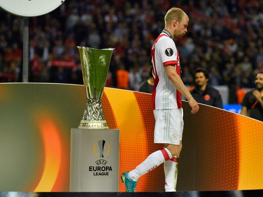 Ajax's Davy Klaassen walks past the trophy at the end of the soccer Europa League final between Ajax Amsterdam and Manchester United at the Friends Arena in Stockholm, Sweden, Wednesday, May 24, 2017. United won 2-0. (AP Photo/Martin Meissner)