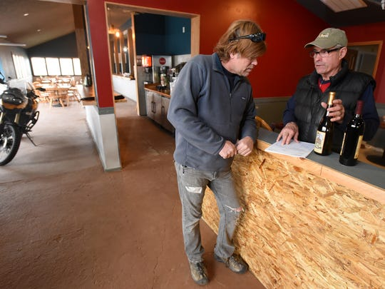 David Haisman, left, co-owner of the Farmington HUB, Brewery and Grill, meets with David Arnold of Wines of the San Juan on Jan. 15 at the new business.