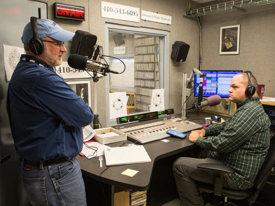 Delmarva Public Radio General Manager, Dana Whitehair, left, and host, Chris Ranck, speaks to their audience during a pledge drive Friday, March 17, 2017.