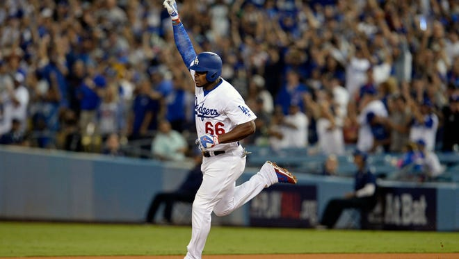 Yasiel Puig celebrates hitting a solo home run in the seventh inning.
