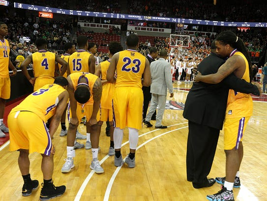 Washington players show their disappointment after