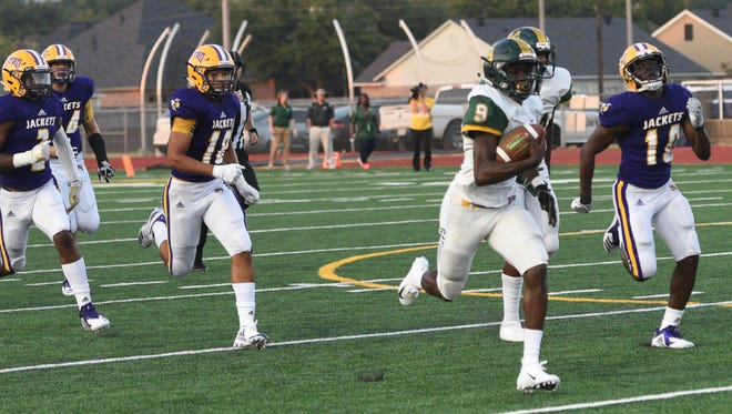 Captain Shreve running back D.J. Fleming (9) scores a 78-yard touchdown during Friday's jamboree against Byrd at Lee Hedges Stadium.