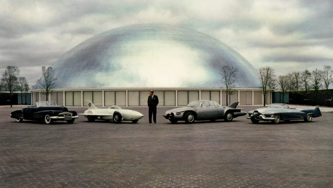 Harley Earl with the Buick Y-Job, Firebird I, Firebird II, and LeSabre Concept cars outside the GM Design Dome at the GM Tech Center in Warren.