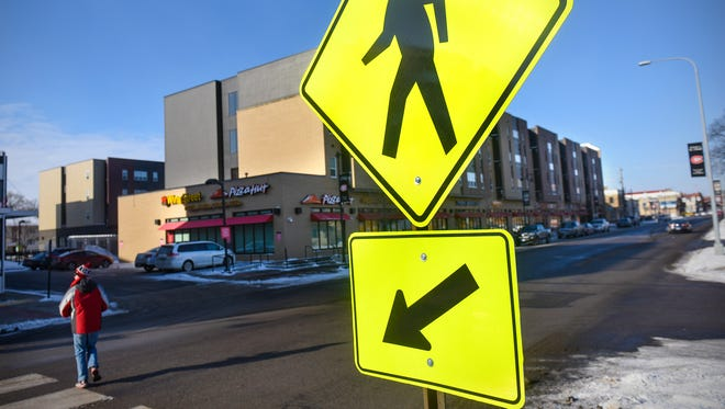 A sign warns motorists of a pedestrian crossing zone Wednesday, Jan. 3, along Fifth Avenue South in St. Cloud.