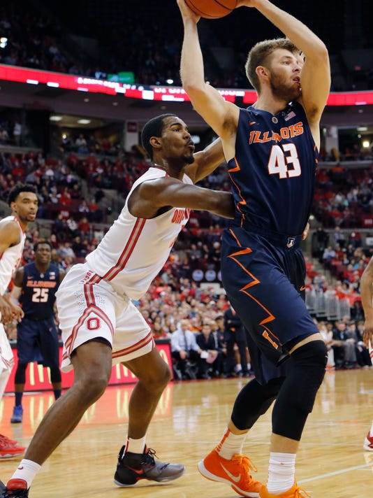Illinois' Michael Finke, right, posts up against Ohio State's Daniel Giddens during the first half of an NCAA college basketball game Sunday, Jan. 3, 2016, in Columbus, Ohio. (AP Photo/Jay LaPrete)