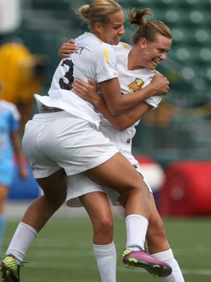 Toni Pressley, left, and Emily Van Egmond celebrate Pressley's tying goal with only seconds left in the 2012 WPSL Elite title match at Sahlen's Stadium.