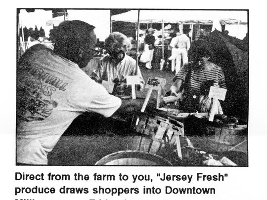 This 1993 photograph from a brochure of the Downtown Millburn Development Alliance (DMDA) shows one of the earliest farmers markets held by the group.