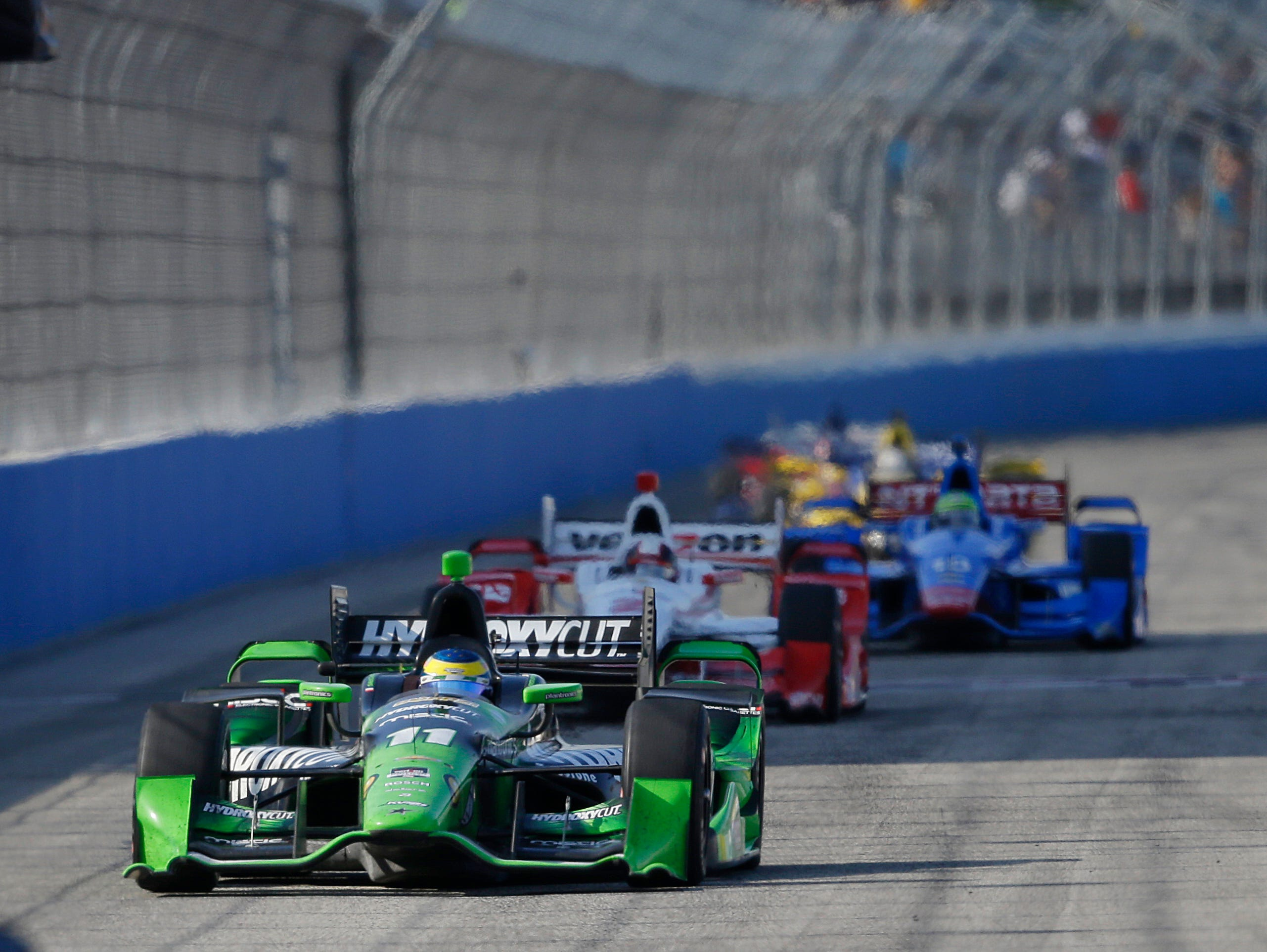 Sebastien Bourdais (11) competes at the IndyCar Series auto race at the Milwaukee Mile in West Allis, Wis., Sunday, July 12, 2015. Bourdais won the race.