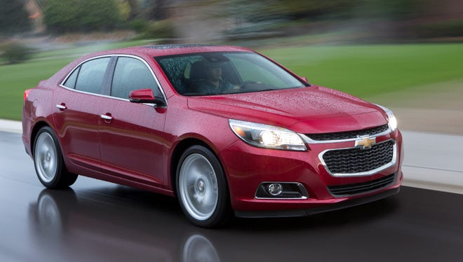 GM is recalling 8,590 of  its 2014 Chevrolet Malibu, pictured, and mechanically similar Buick LaCrosse sedans for a possible brake problem.