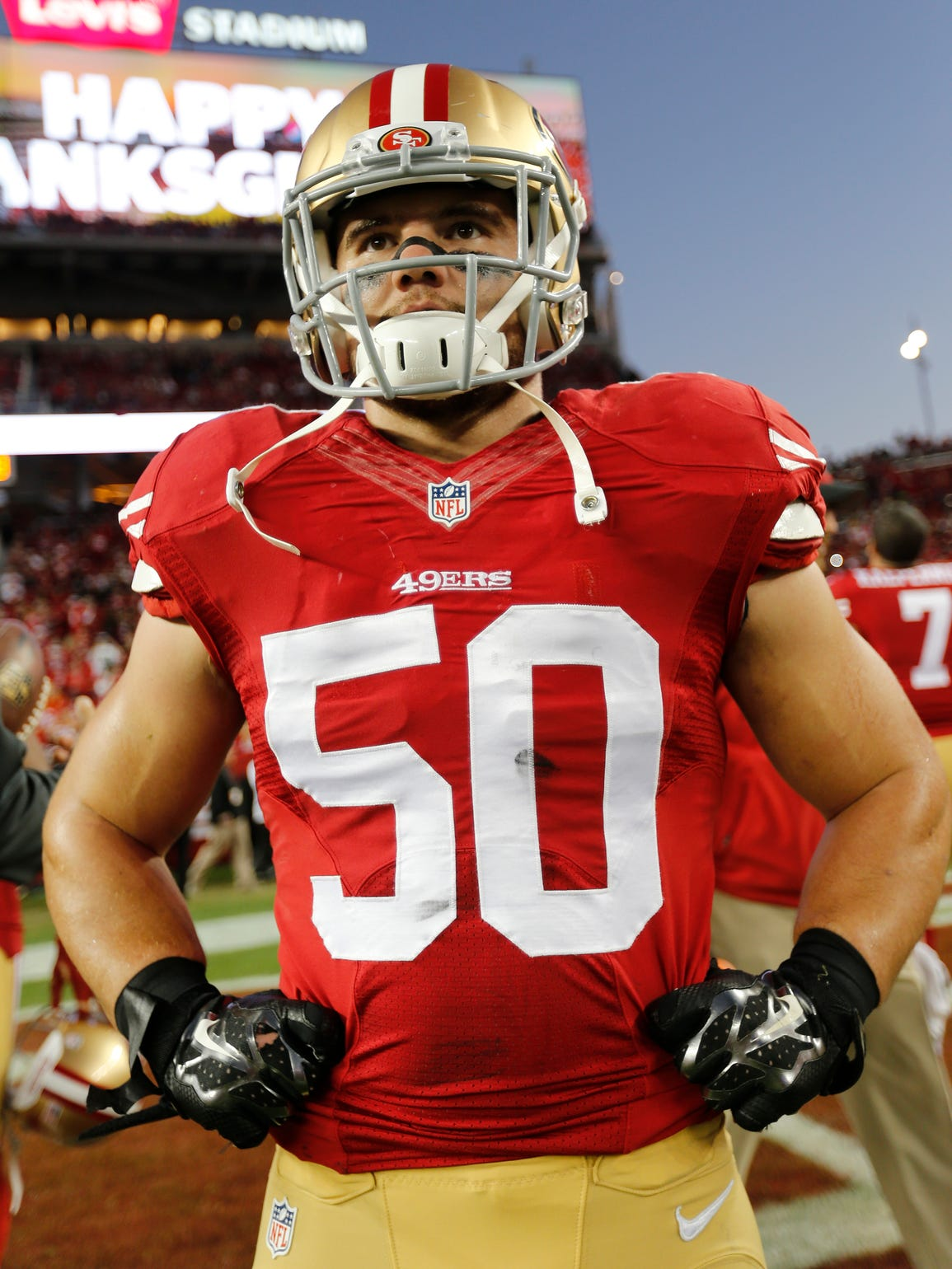 Chris Borland of the San Francisco 49ers stands on