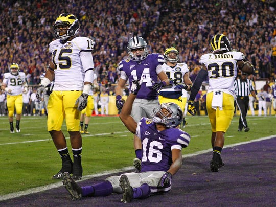 Kansas State celebrates a touchdown against Michigan.