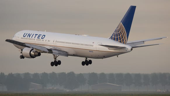 A United Airlines Boeing 767-300 lands at Amsterdam
