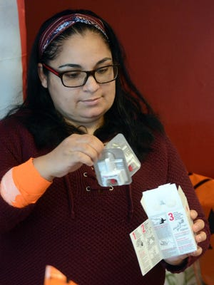 Rosa Cisneros, owner of Rosa's Latin Cuisine in Jewett City, now has Narcan nasal sprays at her restaurant in case of an emergency. The drug, also know as naloxone, reverses the effects of an opioid overdose.