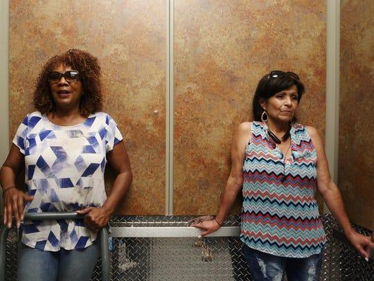 Abeatrice Jones, 66, (left) gets ready to move her