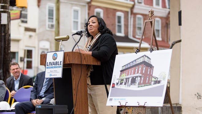 Symanthia Lynch-Sheppard, wife of the late Harry Sheppard, who owned Walt's Flavor Crisp Chicken restaurant at Vandever Avenue and Pine Street in Wilmington, speaks Wednesday at the site.