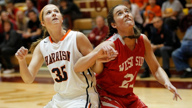 Harrison's Erika Franscoviak and West Lafayette's Lorelei Turner fight for rebounding position in the game for third place of the J&C Hoops Classic November 22, 2014, at McCutcheon High School. Harrison defeated West Lafayette 43-40.