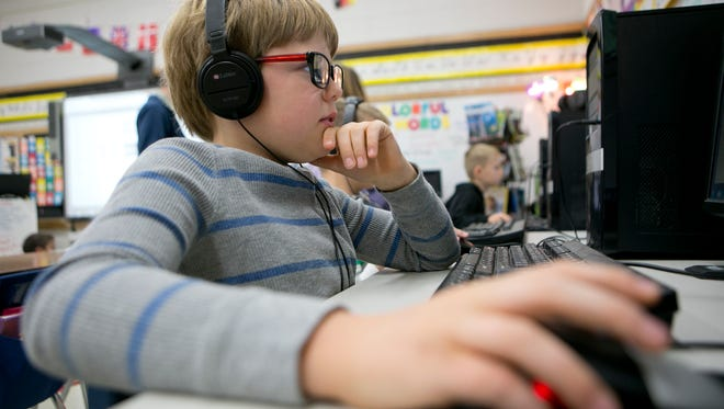 Third-grader Franklin Meadows works on a computer during the Partners In Education Preparing for the Future: Third Grade Coding pilot program at St. Stephen Elementary School in Stevens Point, Tuesday, Nov. 17, 2015.