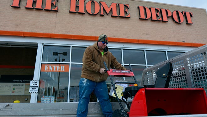 Erik Smetana of Windsor loads a new, heavy duty snow blower into the back of a rented pickup truck, Thursday January 21, 2016. Smetana purchased one of the few remaining snow blowers at The Home Depot in Springettsbury to replace his old one that wouldn't start.