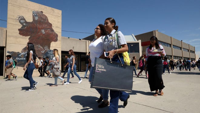 Bowie students Estela Izquierdo and Patricia Vale walk along the Bowie High School campus during lunchtime Wednesday.