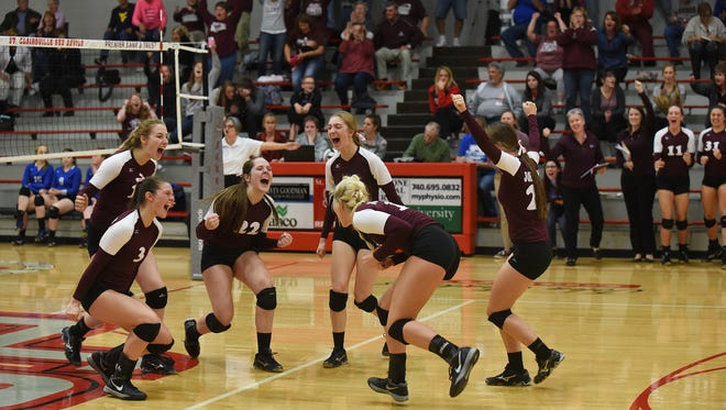 John Glenn celebrates after defeating East Liverpool in four sets at St. Clairsville on Tuesday.