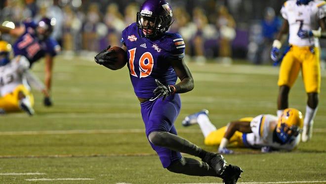 Northwestern State's Ronald Green looks to gain yardage against McNeese State last week.