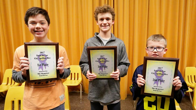Winners of the 41st annual Fond du Lac City-wide Spelling Bee display their plaques Thursday night at Theisen Middle School. From left, first-place winner Jake DeGere, an eighth-grader at  Woodworth Middle School;  third-place winner Sam Lucas, a fifth-grader at St. Mary's Springs Academy; and second-place winner Hunter King, a fourth-grader at Pier Elementary.School. A total of 37 fourth through through eighth graders from 19 area schools competed in the event.