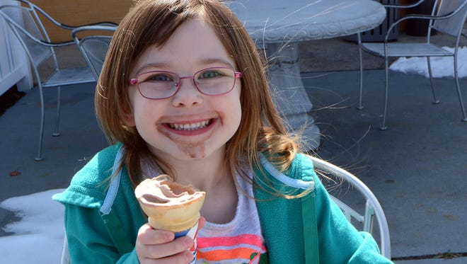 Delilah Why, 4, sports a chocolate mustache while eating her free ice cream cone at Dairy Queen on E. Market St. in Springettsbury Township on the first day of spring, Monday, March 20, 2017.  John A. Pavoncello photo