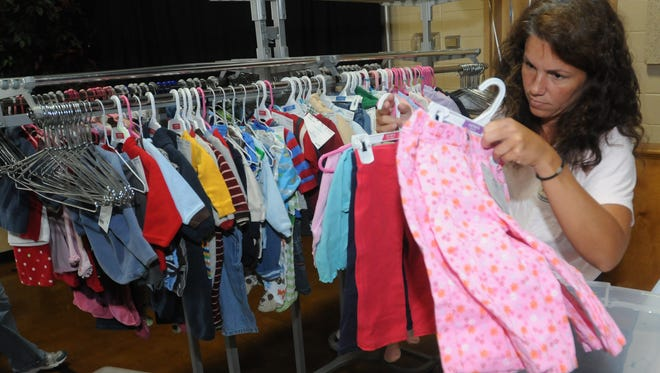 A volunteer with Coastal Kids, checks in items at a previous Coastal Kids Consignment Sale. This year's sale runs from March 30, 2017 through April 1, 2017.