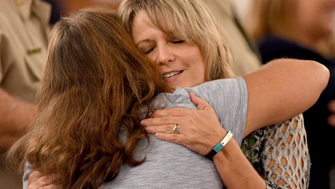 Karen Bobo receives a hug from a supporter after the sentencing hearing for Zach Adams, Saturday, September 23. A Hardin County jury found Zach Adams guilty of all charges including felony first-degree murder, especially aggravated kidnapping, aggravated rape of Holly Bobo. Adams received life plus 50 in his role in the murder of Bobo.