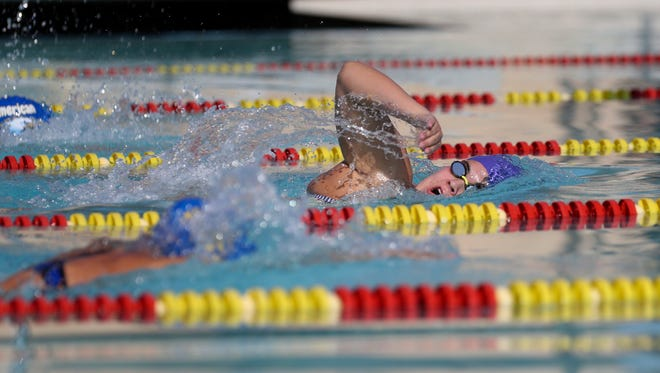 American Christian Academy's Hannah Kozlowski competes in the women's 200 freestyle at West Valley High School in 2017.