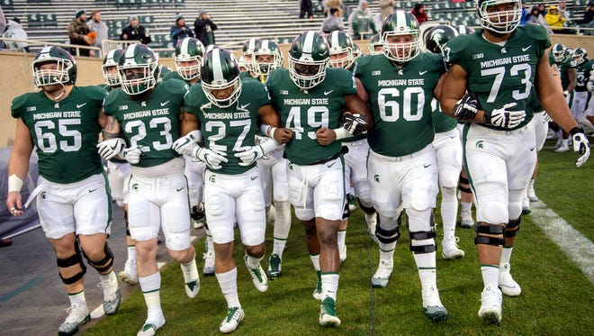 Michigan State Spartans walk onto the field before the start of their game against Maryland on Saturday, November 18, 2017, at Spartan Stadium in East Lansing.