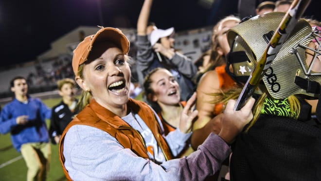 Kristi Costello, Palmyra field hockey head coach, celebrates as Palmyra defeated Penn Manor 3-2 in overtime to claim the PIAA District 3 Class 3A title at Milton Hershey on Saturday, November 5, 2016. Costello stepped down on Thursday after 9 seasons to spend more time with her family.
