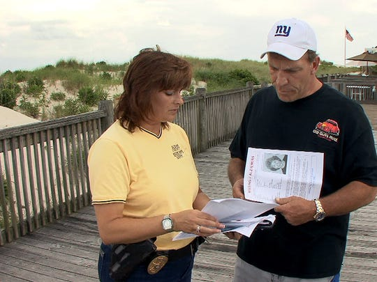 Ocean County Sheriff's Department Det. Lt. Laurie B. Cahill talks with Guy Madsen near the beach at 22nd Avenue in South Seaside Park more than a week after his mother Julia Madsen was last seen.