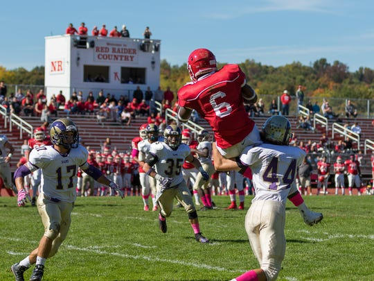 North Rockland wide receiver Jayden Cook is taken down by Brian Fuller of Clarkstown North during a Class AA qualifying round game on Saturday at North Rockland High School in Thiells.