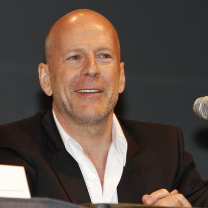 """Bruce Willis Actor Bruce Willis answers a question at panel for the movie """"Red"""" at Comic-Con International Thursday, July 22, 2010 in San Diego."""