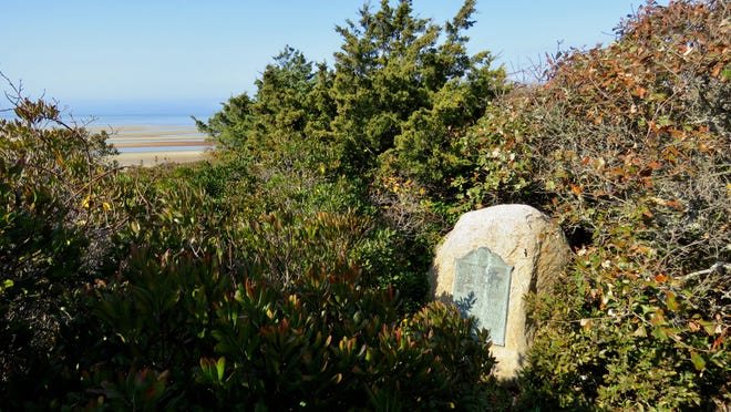 A stone and plaque commemorating the First Encounter between Native Americans and Pilgrims in 1620 is hidden on a hill above the parking lot of First Encounter Beach in Eastham. [Eric Williams/Cape Cod Times]