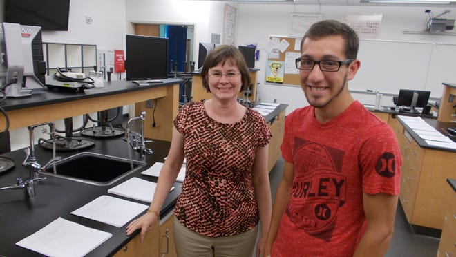 Great Falls College-MSU advisor Sandy Bauman, left, shows studentTyler Green around the school's chemistry lab. In a new program, Green will take his first year's civil engineering classes in Great Falls and then transfer to Montana State University in Bozeman for the last three years.