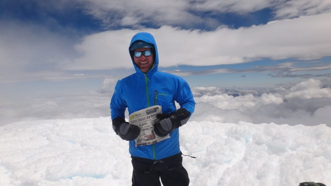 Hi here is a picture for the Travels with the Daily Journal Section.  Kevin Romanik of Millville sent in this picture from Ecuador at the summit of the 19,347-foot-high Cotopaxi mountain. The 10-hour climb was part of a three-week climbing trip to Ecuador that included a climb of the 18,996-foot Cayambe volcano and a visit to the cities of Banos and Quito.