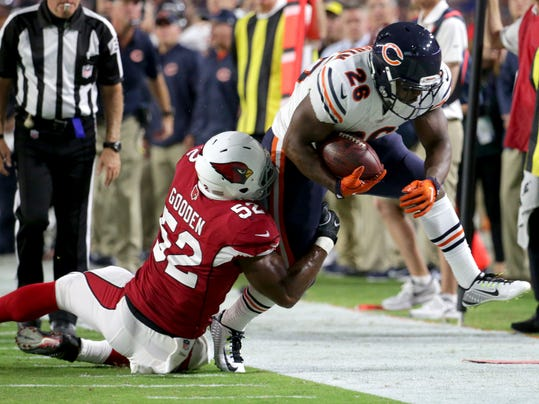 Chicago Bears running back Benny Cunningham (26) is knocked out of bounds by Arizona Cardinals linebacker Zaviar Gooden (52) during the first half of a preseason NFL football game, Saturday, Aug. 19, 2017, in Glendale, Ariz. (AP Photo/Ralph Freso)
