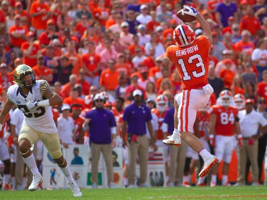 Clemson Tigers wide receiver Hunter Renfrow  catches the ball while being defended by Wake Forest Demon Deacons linebacker Justin Strnad during the first quarter at Clemson Memorial Stadium.