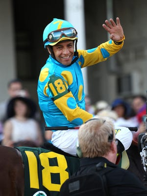 Victor Espinoza, jockey of 'American Pharoah', celebrates after winning his third Kentucky Derby.